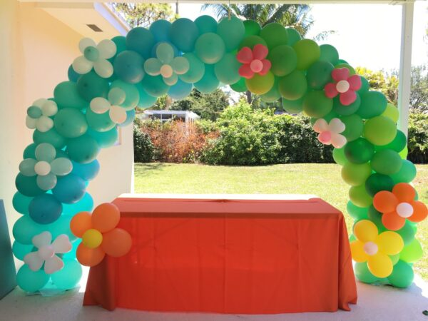 cake table decoration with flower balloon arch