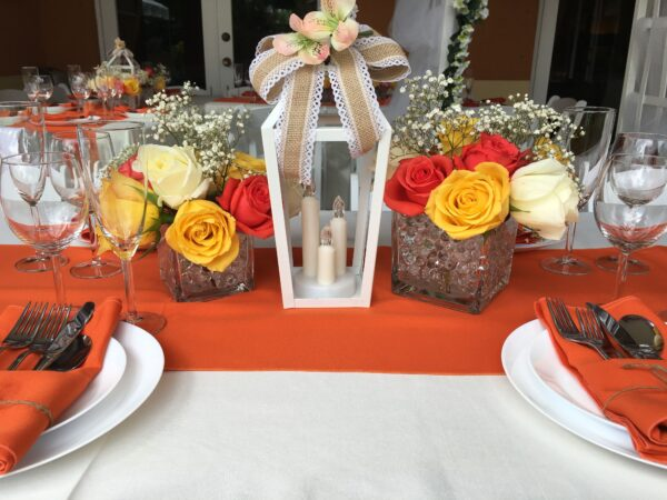 red white and yellow roses table center piece