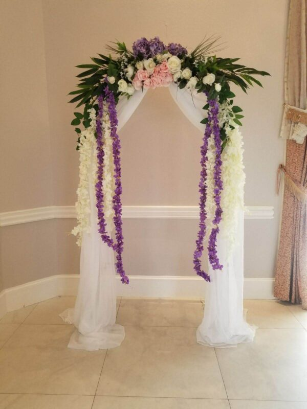 decorated wedding arch with artificial flowers
