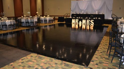 black vinyl wedding portable dance floor rentals