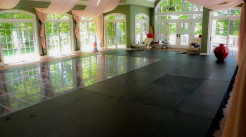 elevated plywood black acrylic pool cover dance floor